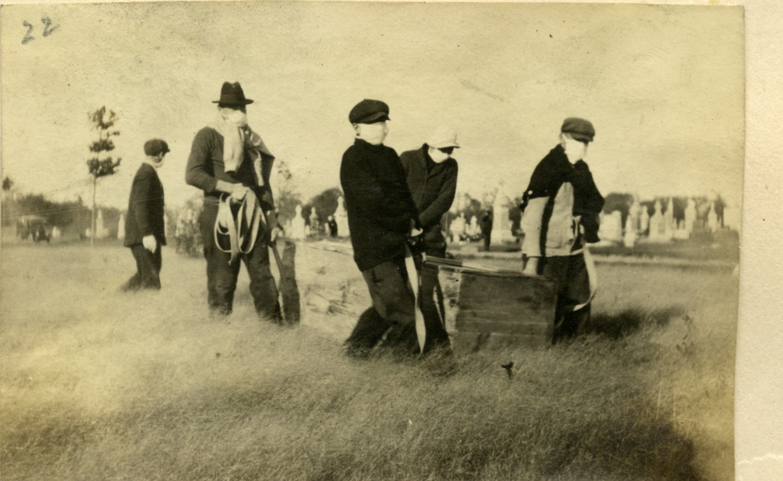 Seminarians carrying caskets