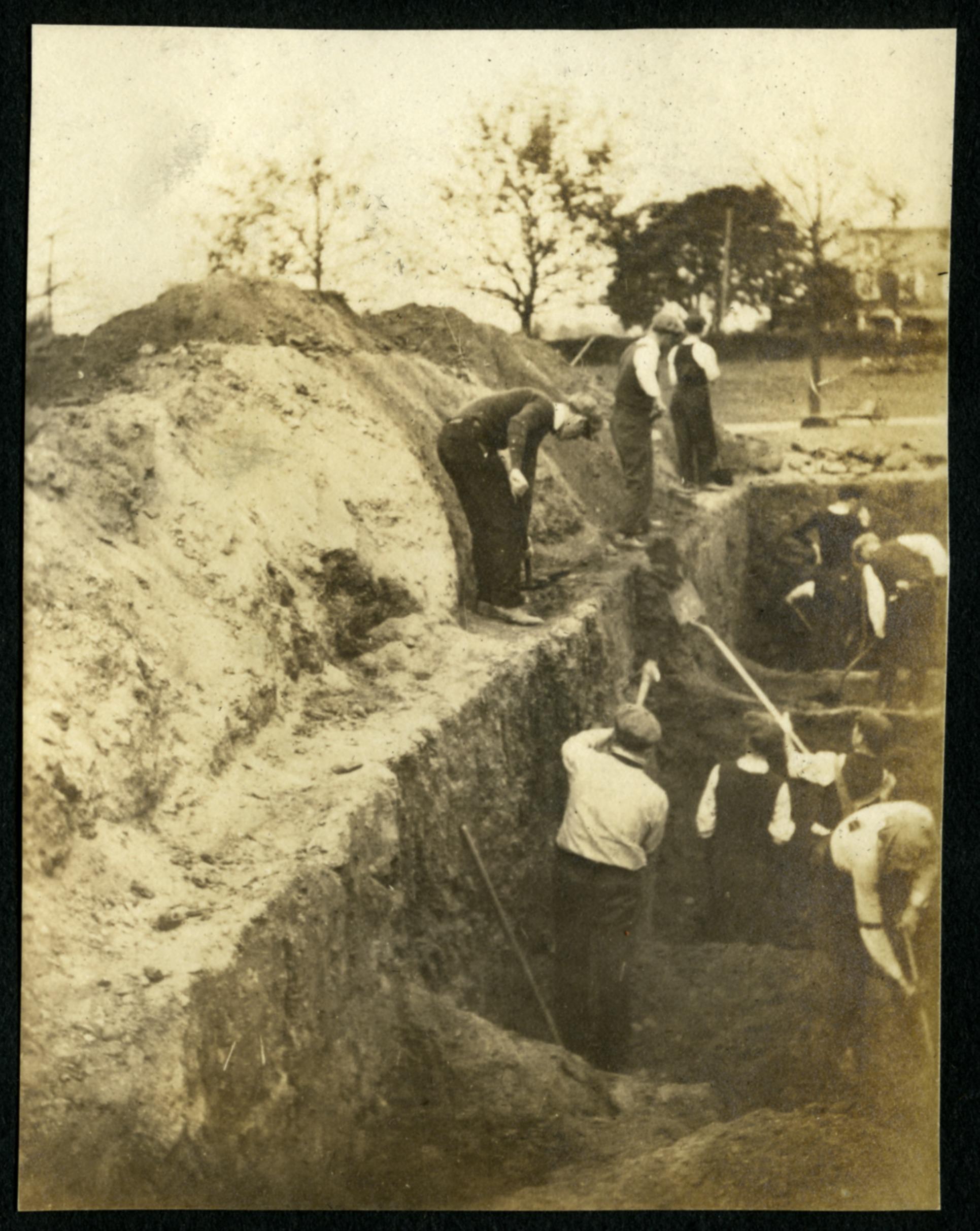 Seminarians digging graves