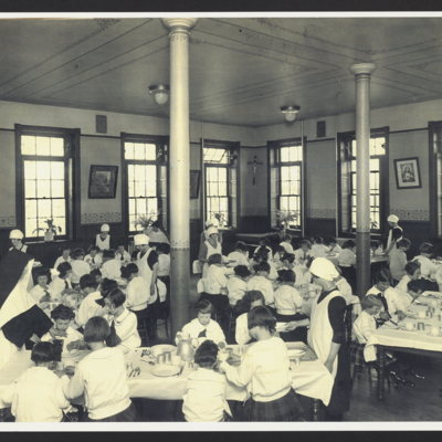 Girls in cafeteria at St. Vincent's Orphanage.